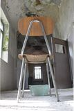 Chair in abandoned psychiatric hospital. Waste in abandoned psychiatric hospital Royalty Free Stock Images