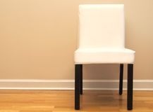 Chair against a beige wall in a home Stock Photos