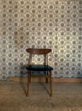 Chair against wall Stock Photography