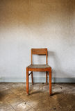 Chair against wall Royalty Free Stock Photography