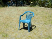 Chair alone in a garden Stock Images