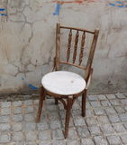 Chair ancient  in the old brick wall Stock Photography