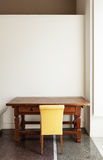 Chair and antique table Royalty Free Stock Image