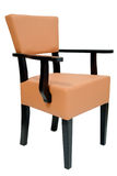 Chair with armrest. Retro design, upholstered in cream leather, or foax leather Stock Images
