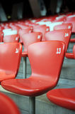 Chair array. A red and white chair with number array in stadium stock photography