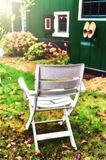 Chair in autumn backyard garden Stock Image