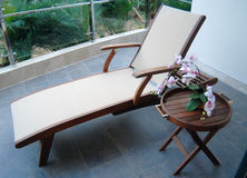 Chair on balcony. Balcony with wood/aluminum chair and table Royalty Free Stock Image