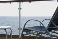 Chair on Balcony. Chair on cruise ship balcony Stock Photography