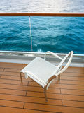 Chair on balcony of cruise liner Stock Photos