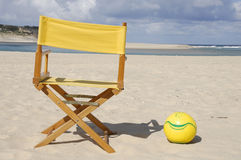 Chair, ball on the beach. Yellow chair and ball on the beach Stock Image