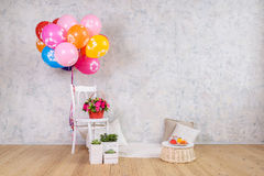 Chair and balloons, flowers basket and cake. Birthday Stock Image