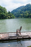 A chair on the bamboo raft in cihu, taiwan Royalty Free Stock Photography