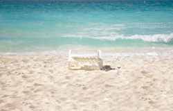 Chair on beach. Chair isolated on a beautiful beach with sea in back Royalty Free Stock Image