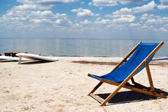 Chair on a beach. Against a gulf and clouds Royalty Free Stock Photography