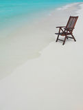 Chair on the beach. With hat Royalty Free Stock Photography