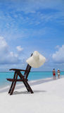 Chair on the beach. Hair on the beach with hat Royalty Free Stock Image