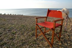 Chair on the beach Stock Images
