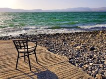 Chair on beach of Sea of Galilee lake Stock Image