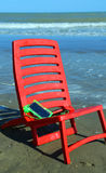 Chair on the beach with a smartphone Stock Images