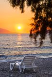 Chair on beach at sunset Royalty Free Stock Photos