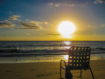 Chair on the beach at sunset, island of Maui, Hawa Stock Images