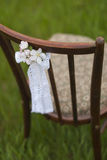 Chair and beautiful little flowers. On grass Stock Photos