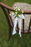 Chair and beautiful little flowers. On grass Royalty Free Stock Photography
