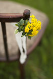 Chair and beautiful little flowers. On grass Stock Image