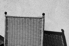 A chair in black and white showing its shadow Royalty Free Stock Photos