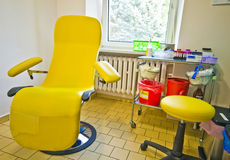 Chair in blood lab. Yellow chair for blood donations in blood testing lab royalty free stock photos