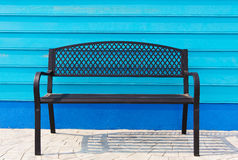 Chair on blue wall Royalty Free Stock Photo