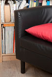 Chair and bookcase Royalty Free Stock Photography