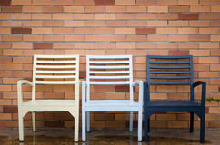 Chair and brick wall Royalty Free Stock Photos