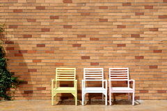 Chair and brick wall Stock Image