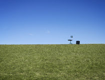 Chair and briefcase on grass Stock Photos