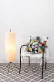 Chair with bright cushion and elegant floor lamp. Home decorating. Chair with bright cushion and elegant floor lamp stock images