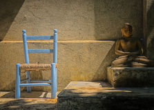 Chair and buddha Royalty Free Stock Images