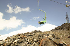 Chair cableway mountains in the background Royalty Free Stock Photo