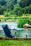 Chair for camping on the river Bank Royalty Free Stock Photography