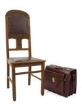 Chair and case. Wooden chair and the leather suitcase Stock Image