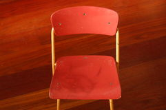 Chair for children. A small chair on a wooden floor Royalty Free Stock Image