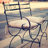 Chair in the city Royalty Free Stock Photos