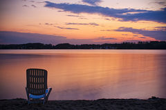 Chair on coast water Royalty Free Stock Images