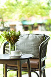 Chair and coffee table in a decorative setting Royalty Free Stock Images