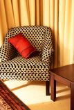 Chair with colorful cushions. Colorful cushion on a beautiful chair in a guest lodge royalty free stock photography