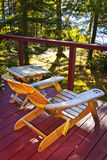 Chair on cottage deck Royalty Free Stock Photo