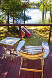 Chair on cottage deck stock image