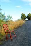 Chair on country road Royalty Free Stock Image