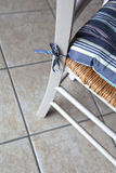 Chair. Cushion on a rustic chair in a kitchen stock photos