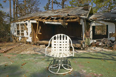 Chair and debris in front of house heavily hit by Hurricane Ivan in Pensacola Florida Stock Photos